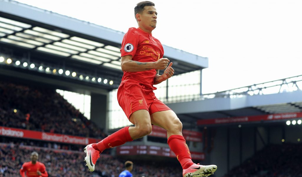 Liverpool's Philippe Coutinho celebrates scoring his side's second goal, during the English Premier League soccer match between Liverpool and Everton, at Anfield, in Liverpool, England